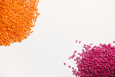 Plastic granules close up for holding,Colorful plastic granules with white background. and dollar money,Plastic Business.