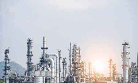 Industrial zone,The equipment of oil refining,Close-up of industrial pipelines of an oil-refinery plant,Detail of oil pipeline with valves in large oil refinery. Banco de Imagens