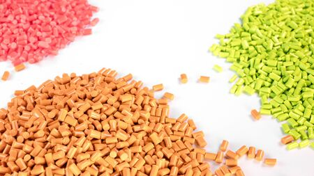 Plastic granules close up for holding,Colorful plastic granules with white background