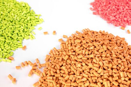 plastic granules close up for holding,Colorful plastic granules with white background. Stock Photo