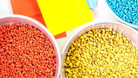 plastic granules close up for holding, Colorful plastic granules with white background.
