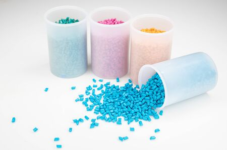 Plastic granules close up for holding,Colorful plastic granules with white background. and dollar money,Plastic Business,Plastic industry.