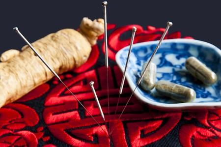 Acupuncture needles,ginseng root and herbal pills Stock Photo - 8142751