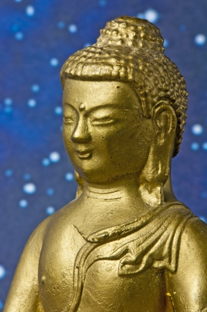 Buddha with a background of stars photo