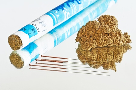 moxibustion: acupuncture needle and moxibustion