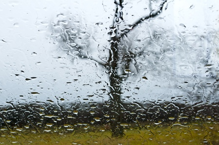 car window with rain drops photo