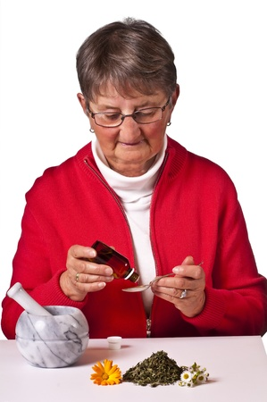 pensioner taking herbal drops Stock Photo - 11741989