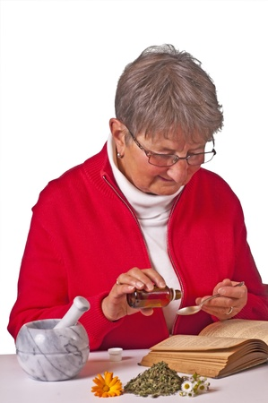 pensioner taking herbal drops Stock Photo - 11741983