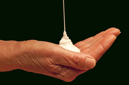 hand with bodylotion photo