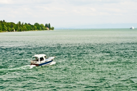 Alpes: Bodensee, Germany, boat and view to the Alpes Stock Photo