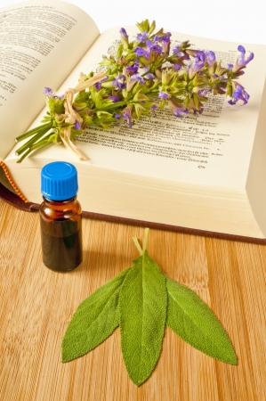 tincture: sage with herbal tincture and medieval book Stock Photo