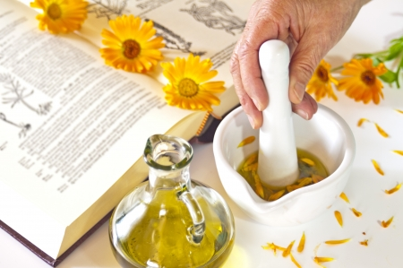 preparing of calendula oil Stock Photo