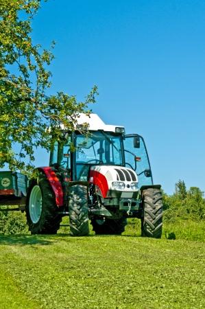 tractor under apple tree photo