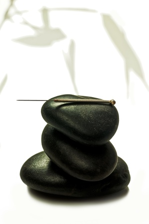 acupuncture needle on stone Stock Photo - 16518193