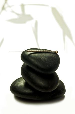 acupuncture needle on stone