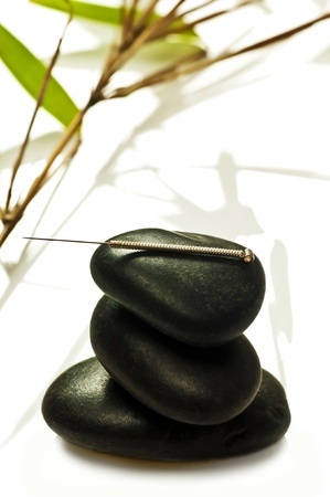acupuncture needle on stone