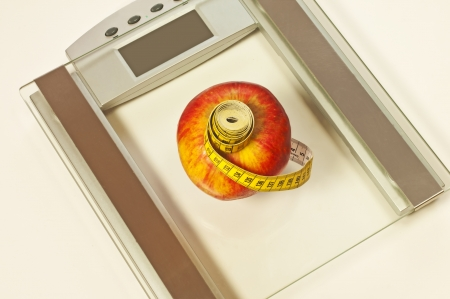 bathroom scales with measure and apple photo
