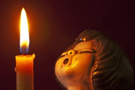 jubilating: angel with candle