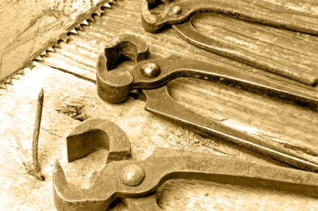old rusty pliers with nail Stock Photo - 18782678
