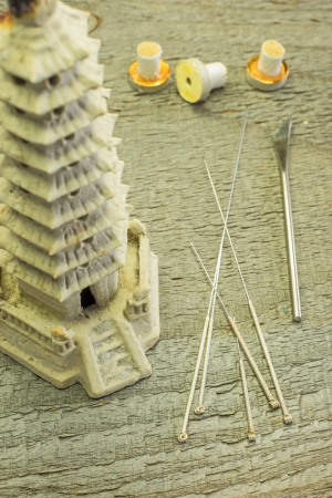 acupuncture needles and moxibustion cones photo