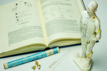 Acupuncture needles and textbook