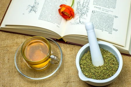 Rockrose tea with medieval textbook Stock Photo - 22842872