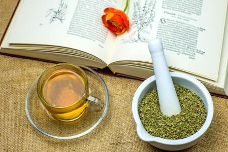 Rockrose tea with medieval textbook Stock Photo - 22842872