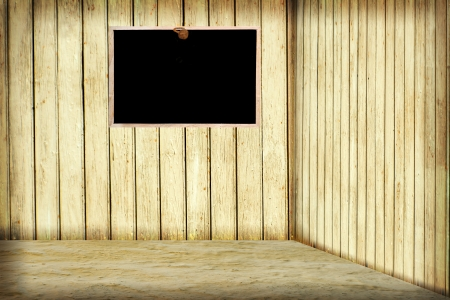 Room with wooden wall and blackboard photo
