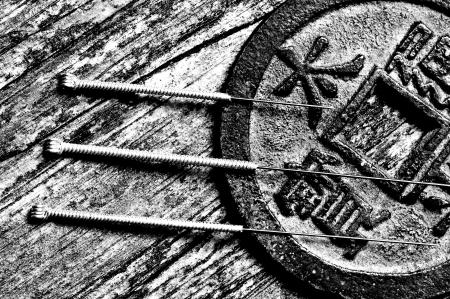 antique coins: acupuncture needles Editorial