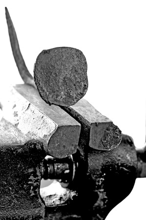 old bench vise with rusty nail photo