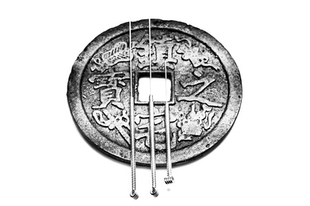 Acupuncture needles with antique chinese coin Stock Photo - 24760315