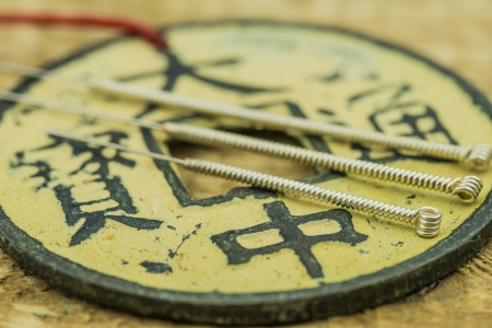 Acupuncture needles with antique chinese coin Stock Photo - 24972445