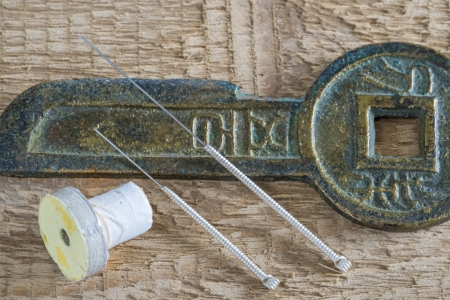 Acupuncture needles with antique chinese coin Stock Photo - 25212857