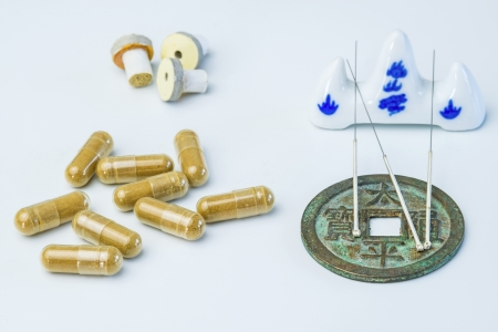 warming therapy: Acupuncture needles, moxa cones, herbal pills