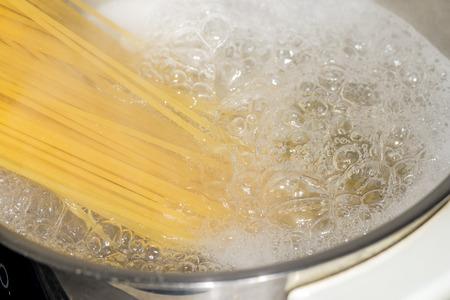 Spaghetti in boiling water photo