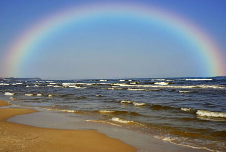 Coastline of the Baltic sea with rainbow Stok Fotoğraf