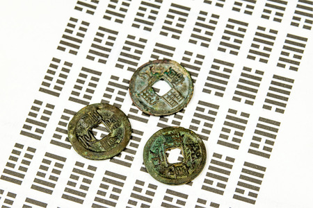 divination: I Ging, Chinese divination with coins Stock Photo