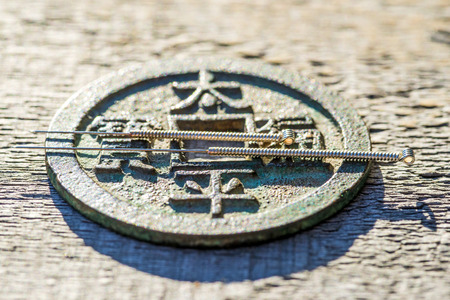 the world cultural heritage: acupuncture needles on chinese coin Stock Photo