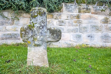penitence: penitence cross with old medieval abbey wall Stock Photo