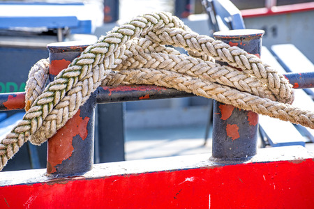 the mooring: Cleat with mooring line of a trawler Stock Photo