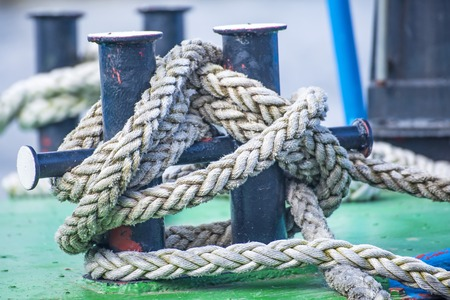 fixed line: Cleat with mooring line of a trawler Stock Photo