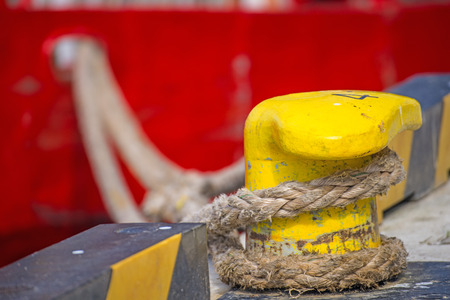 mooring: Bollard with mooring line of a trawler