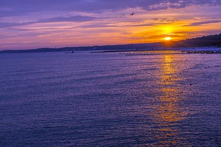groynes: Sunrise over the Baltic Sea with groynes