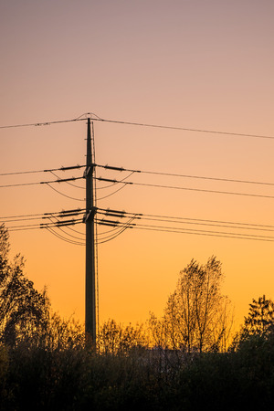 afterglow: sunset with afterglow and power mast