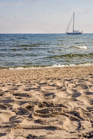 clear away: Sailboat anchored on a beach in the Baltic Sea Stock Photo