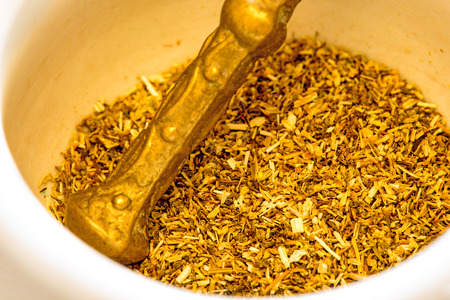 nature cure: Chamomile, dried with mortar