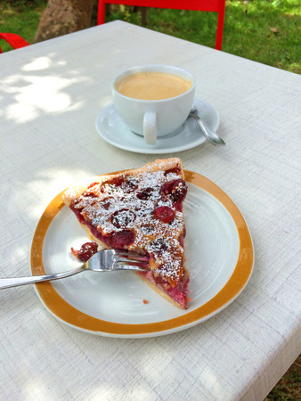 cafe au lait: French horticulture with cafe au lait and cherry pie Stock Photo