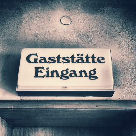 60s: old German door sign of a restaurant of the 60s