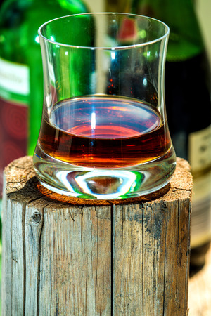 whiskey glass: Whiskey glass on wooden stand Stock Photo