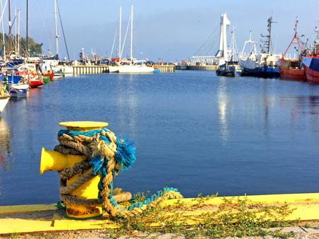 bollard: bollard in a seaport with ships Stock Photo